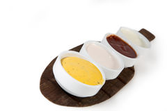 Sauces in bowls isolated on white with mustard, ketchup, yogurt Royalty Free Stock Photos