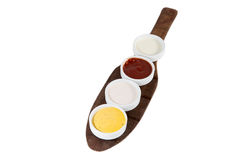 Sauces in bowls isolated on white with mustard, ketchup, yogurt Royalty Free Stock Photo