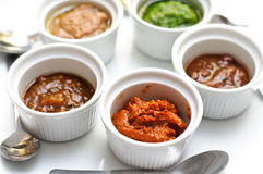 Sauces and dips on a plate. Ramekins with sauces and dips stock image