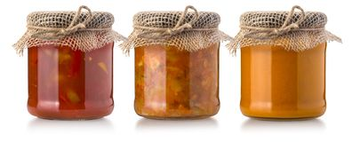 Sauces in glass bottle Stock Images