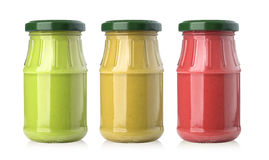 Sauces in glass jars Stock Image