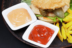 Sauces and hamburger with breast cutlet Royalty Free Stock Photography