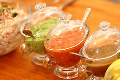 Sauces. Three types of sauce in glass sauce-boats Royalty Free Stock Image