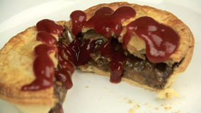 Saucing Meat Pie stock video