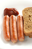 Saucisse avec la sauce tomate Image stock
