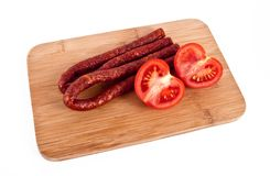 Saucisse avec la tomate Images libres de droits