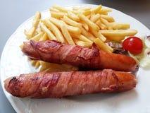 Saucisse de Francfort avec le français frit Image stock