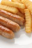 Saucisse et pommes chips Image stock