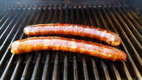 Saucisse fumée sur le gril Image libre de droits