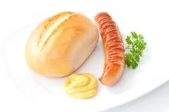 Saucisse grillée, moutarde, pain, persil Images libres de droits