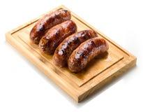 Saucisse rôtie sur le gril. Photos stock