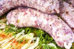 Saucisses avec des légumes Photographie stock