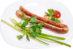 Saucisses de Fried Munich avec des sauces, l'oignon vert et le persil Image libre de droits