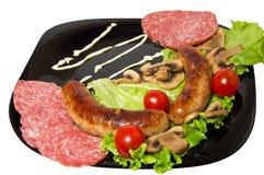 Saucisses grillées, dîner simple Image libre de droits