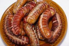 Saucisses grillées d'une plaque Image libre de droits