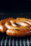 Saucisses grillées sur le gril Photo libre de droits