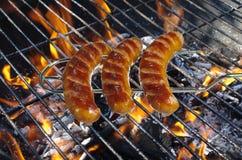 Saucisses sur la fourchette Photos stock