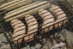 Saucisses sur le gril Image stock