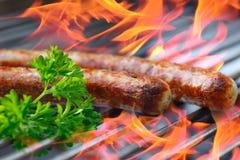 Saucisses sur le gril Image libre de droits