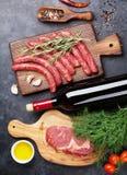 Saucisses, viande, vin rouge Photos stock