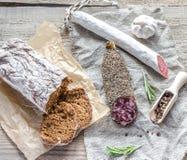 Saucisson and spanish salami on the sackcloth Stock Photo