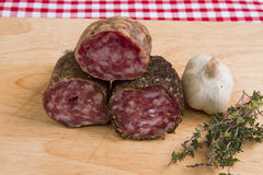 Saucisson. Three different types of French saucisson with garlic and tyme Royalty Free Stock Photo