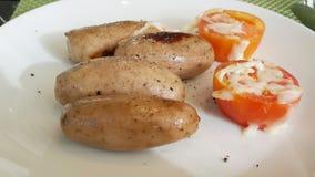Saucsage and tomato Stock Photography