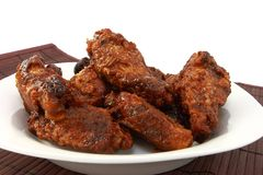Saucy Chicken Wings In A White Dish Stock Photos