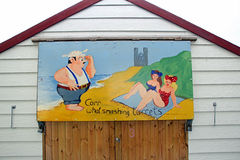 Saucy postcard beach hut painting Stock Images