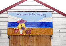 Saucy postcard beach hut painting. Photo of a saucy postcard painting on beach hut typical of british 1960/70's postcards sent from holiday destinations Stock Photo
