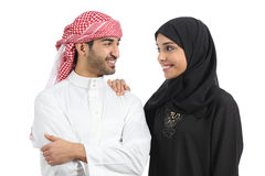 Saudi arab couple marriage looking with love. Isolate don a white background Stock Photos