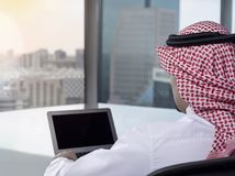 Saudi Arab Man Watching Laptop at Work Contemplating stock photo