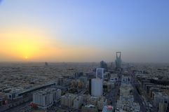 Riyadh skyline at sunset, showing kingdom tower Stock Photo