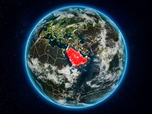 Saudi Arabia on Earth at night. Saudi Arabia from space on planet Earth at night with visible country borders. 3D illustration. Elements of this image furnished Royalty Free Illustration