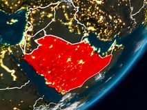 Saudi Arabia on Earth at night. Saudi Arabia from space on planet Earth at night with visible country borders. 3D illustration. Elements of this image furnished royalty free stock image