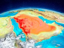 Saudi Arabia on Earth. Orbit view of Saudi Arabia highlighted in red on planet Earth with highly detailed surface textures. 3D illustration. Elements of this Stock Photos