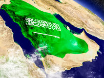 Saudi Arabia with embedded flag on Earth Royalty Free Stock Photo