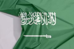 Saudi Arabia fabric flag crepe and crease with white space. Saudi Arabia fabric flag crepe and crease with white space, a green field with the Shahada or Muslim stock images
