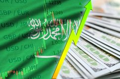 Saudi Arabia flag and chart growing US dollar position with a fan of dollar bills. Concept of increasing value of US dollar currency stock photos
