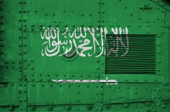 Free Saudi Arabia Flag Depicted On Side Part Of Military Armored Tank Closeup. Army Forces Conceptual Background Stock Image - 165863791