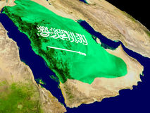 Saudi Arabia with flag on Earth Royalty Free Stock Images