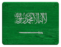 Saudi Arabia flag. Painted on wooden tag stock photos