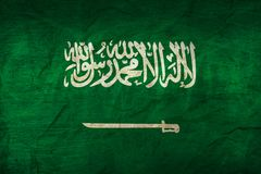 Saudi Arabia Flag on Paper. Flag on an old Paper Texture Royalty Free Stock Image