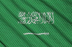 Saudi Arabia flag printed on a polyester nylon sportswear mesh f. Abric with some folds royalty free stock photos