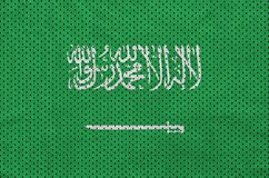 Saudi Arabia flag printed on a polyester nylon sportswear mesh f. Abric with some folds royalty free stock photography