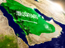 Saudi Arabia with flag in rising sun Royalty Free Stock Photos