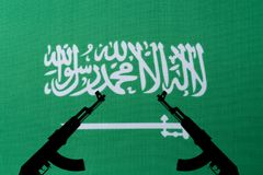 Saudi Arabia flag and the silhouette of the weapon. The concept of war and armed conflict stock images