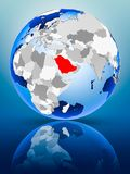 Saudi Arabia on globe. Saudi Arabia on political globe standing on reflective surface. 3D illustration stock illustration