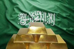 Saudi arabia gold reserves. Shining golden bullions on the saudi arabia flag background Stock Image