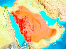 Saudi Arabia in red on Earth. Saudi Arabia highlighted in red on planet Earth. 3D illustration. Elements of this image furnished by NASA Royalty Free Stock Photography